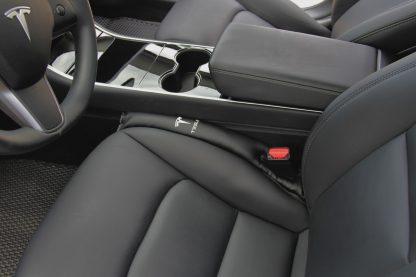 Model 3 seat gap insert driver side