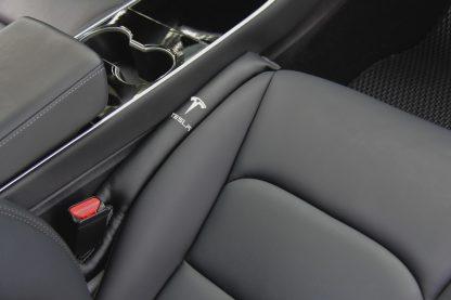 Model 3 seat gap insert passenger top side