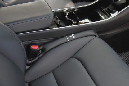 Model 3 seat gap insert passenger side